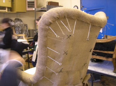 using skewers to hold the hessian in position, waiting for stitching